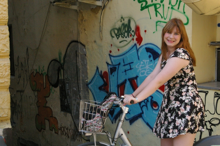 In her sophomore year, Lexi will take a class that exegetes community on a bike. Here she is in Ljubljana 'practicing'