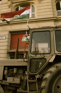 a tractor on the busy streets of Budapest joins in the march