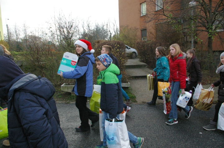 Children from the International Christian School in Budapest deliver presents that they collected