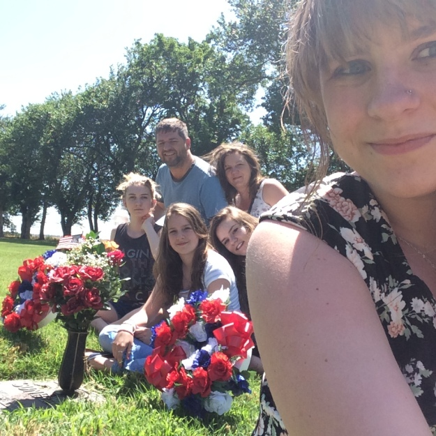 In Hutchinson, KS - visiting the graves of Jay's parents, Bill and Thelma Sunberg. Jenna, Lydia, and Sophie do not remember their Grandpa. Jenna & Lydia have small memories of their Grandma